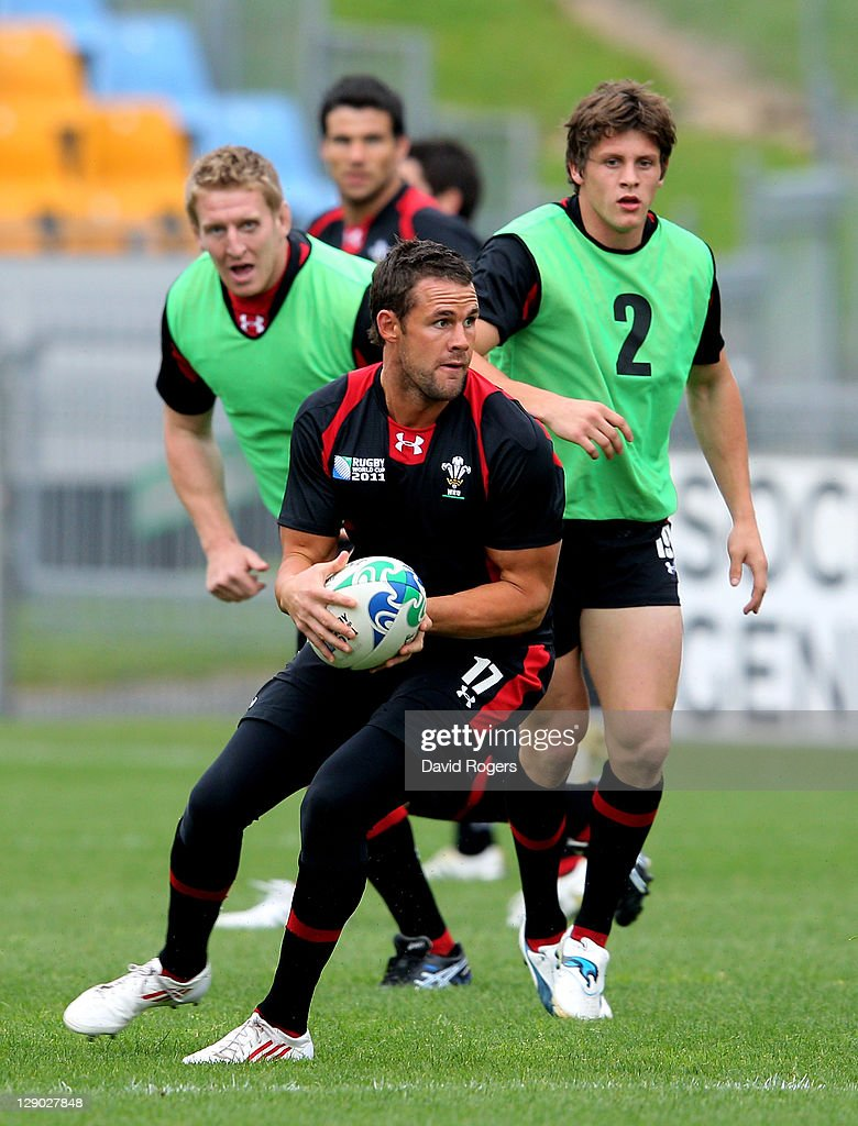 Fullback <a gi-track='captionPersonalityLinkClicked' href=/galleries/search?phrase=Lee+Byrne&family=editorial&specificpeople=460147 ng-click='$event.stopPropagation()'>Lee Byrne</a> looks fo support during a Wales IRB Rugby World Cup 2011 training session at Mt Smart Stadium on October 11, 2011 in Auckland, New Zealand.