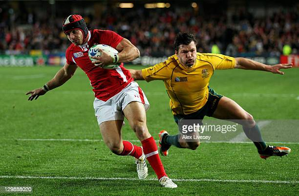 Fullback Leigh Halfpenny of Wales evades the challenge from Adam AshleyCooper of the Wallabies to score his team's second try during the 2011 IRB...
