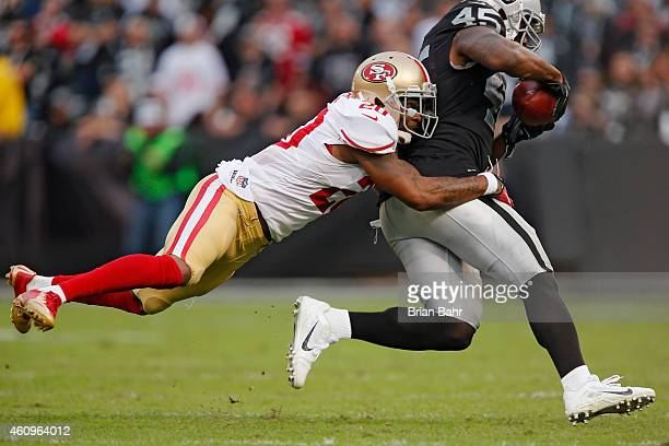 Fullback Marcel Reece of the Oakland Raiders makes a catch for five yards against cornerback Perrish Cox of the San Francisco 49ers at the end of the...