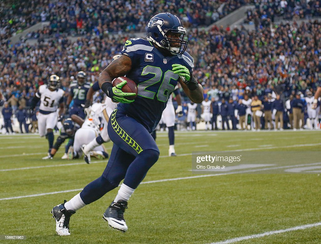 Fullback Michael Robinson #26 of the Seattle Seahawks rushes for a touchdown in the third quarter against the St. Louis Rams at CenturyLink Field on December 30, 2012 in Seattle, Washington. The Seahawks defeated the Rams 20-13.