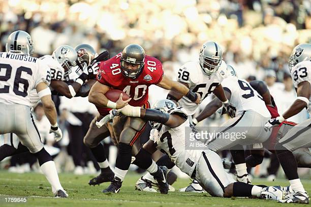 Fullback Mike Alstott of the Tampa Bay Buccaneers rushes upfield against the Oakland Raiders during Super Bowl XXXVII at Qualcomm Stadium on January...