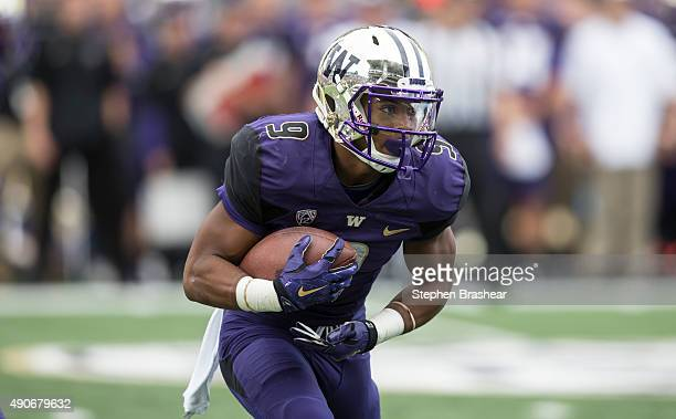 Fullback Myles Gaskin of the Washington Huskies runs with the ball during a game against the California Golden Bears at Husky Stadium on September 26...