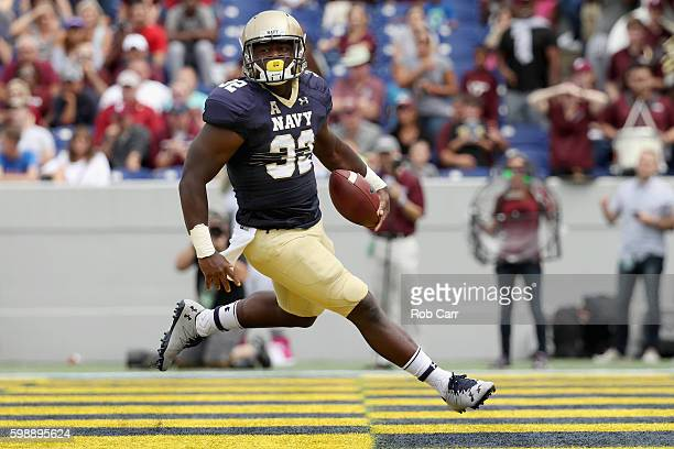 Fullback Myles Swain of the Navy Midshipmen scores a first quarter touchdown against the Fordham Rams at NavyMarine Corps Memorial Stadium on...