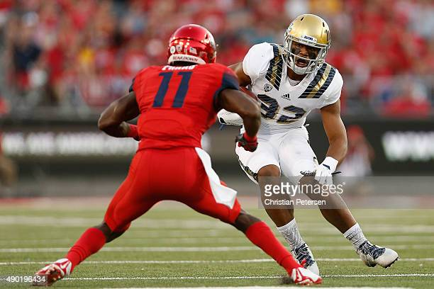 Fullback Nate Iese of the UCLA Bruins runs with the football against safety Will Parks of the Arizona Wildcats during the first quarter of the...