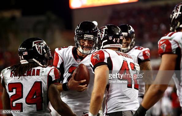 Fullback Patrick DiMarco of the Atlanta Falcons celebrates his touchdown with quarterback Matt Ryan and running back Devonta Freeman during the third...