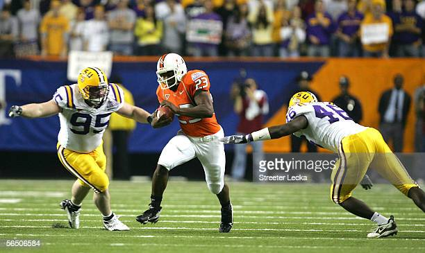 Fullback Quadtrine Hill of the Miami Hurricanes runs against the defense of Kyle Williams of the LSU Tigers during the ChickfilA Peach Bowl on...