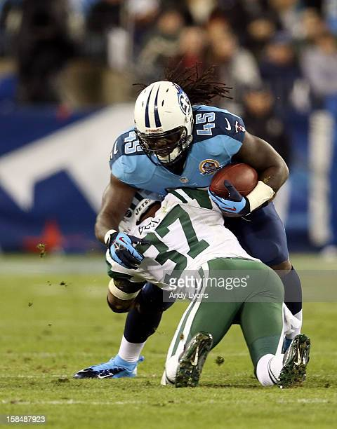 Fullback Quinn Johnson of the Tennessee Titans gets tackled by strong safety Yeremiah Bell of the New York Jets at LP Field on December 17 2012 in...