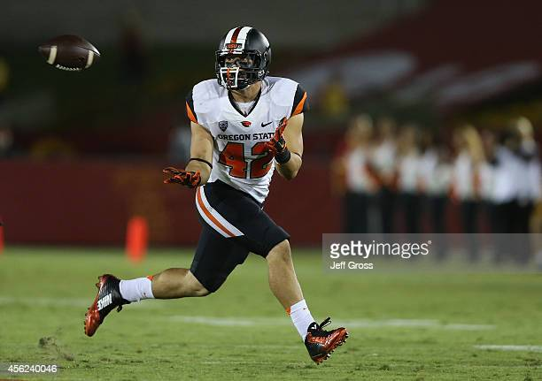 Fullback Ricky Ortiz of the Oregon State Beavers catches a pass in the second half against the USC Trojans at Los Angeles Memorial Coliseum on...
