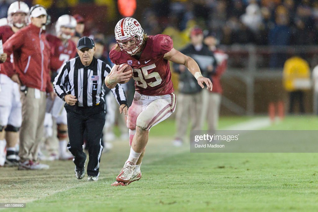 Fullback <a gi-track='captionPersonalityLinkClicked' href=/galleries/search?phrase=Ryan+Hewitt+-+American+Football+Player&family=editorial&specificpeople=13543993 ng-click='$event.stopPropagation()'>Ryan Hewitt</a> #85 of the Stanford Cardinal runs with the ball during a PAC-12 NCAA football game against the California Golden Bears played on November 19, 2011 at Stanford Stadium in Palo Alto, California. It was the 114th playing of the Big Game between the two schools.