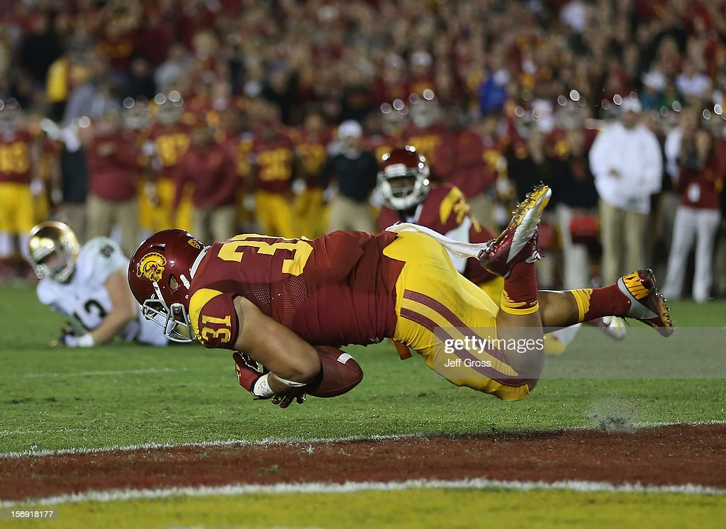 Fullback Soma Vainuku #31 of the USC Trojans can't make a catch in the closing minutes of the fourth quarter against the Notre Dame Fighting Irish at Los Angeles Memorial Coliseum on November 24, 2012 in Los Angeles, California. Notre Dame defeated USC Trojans 22-13.