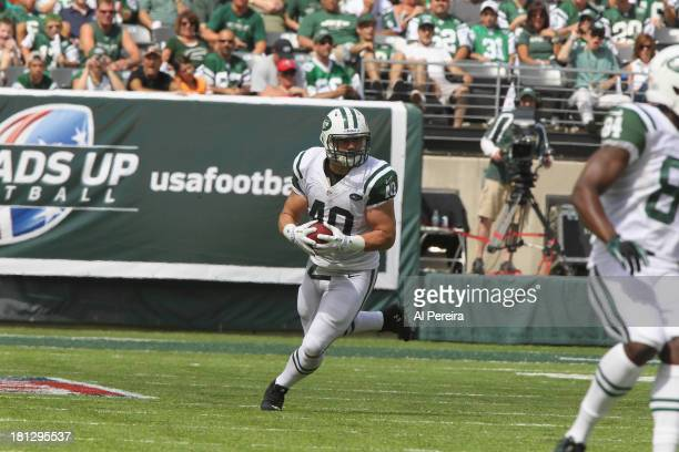 Fullback Tommy Bohanon of the New York Jets has a long gain against the Tampa Bay Buccaneers at MetLife Stadium on September 8 2013 in East...