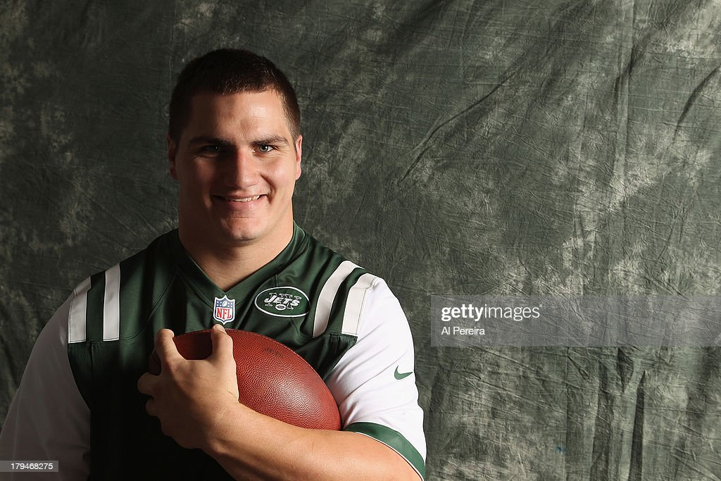 Fullback Tommy Bohanon #40 of the New York Jets poses during a portrait session on September 1, 2013 in Florham Park, New Jersey.