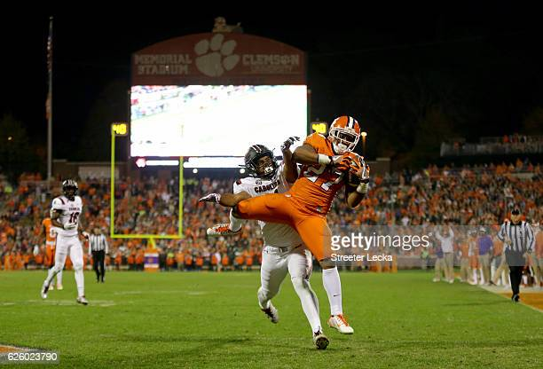 J Fuller of the Clemson Tigers catches a touchdown over TJ Holloman of the South Carolina Gamecocks during their game at Memorial Stadium on November...