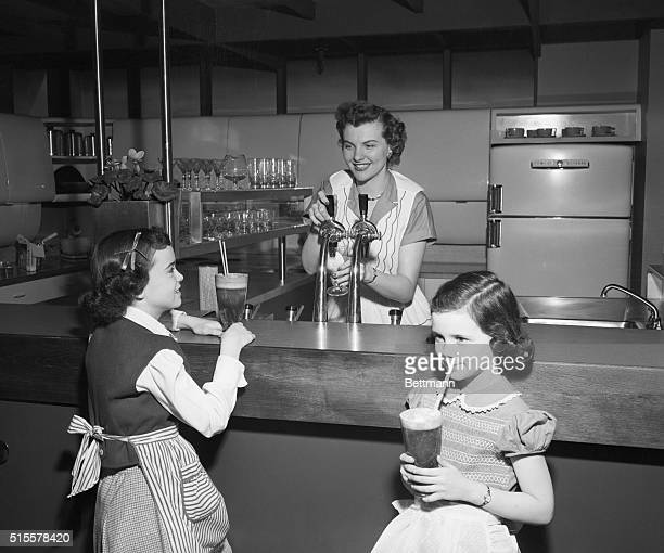 2/2/1951A fullfledged soda fountain is a popular feature of this kitchen particularly with children Along far wall is refrigerator stove and food...