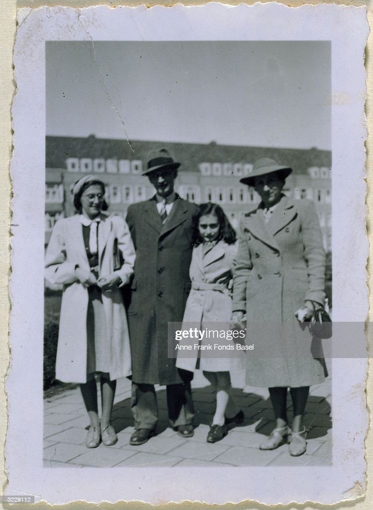 Full-length family portrait of (left to right) Margot, Otto, Anne (1929 - 1945), and Edith Frank at the Merwedeplein, taken from Anne's photo album, Amsterdam, Holland, 1941.