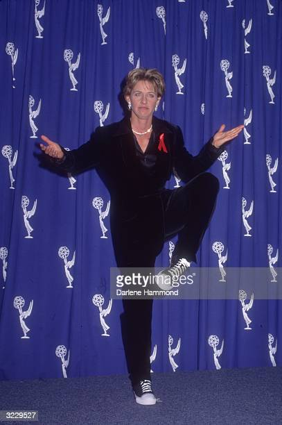 Fulllength image of American actor and comedian Ellen DeGeneres posing on one leg backstage at the Emmy Awards Pasadena California DeGeneres was...