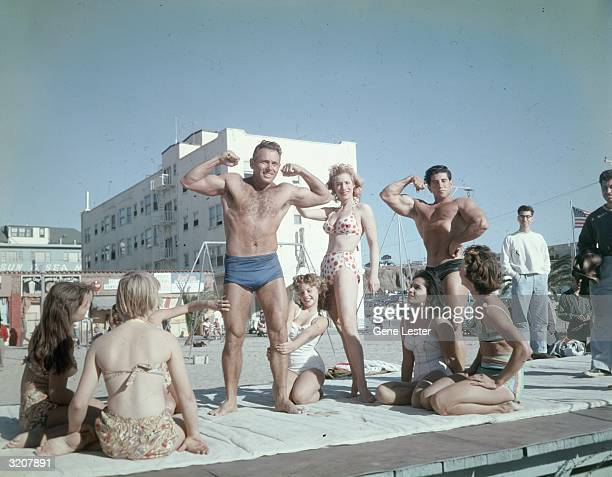 Fulllength image of DeForrest Most supervisor of the Muscle Beach area for Santa Monica Parks flexing his muscles Santa Monica California Kim Curtis...