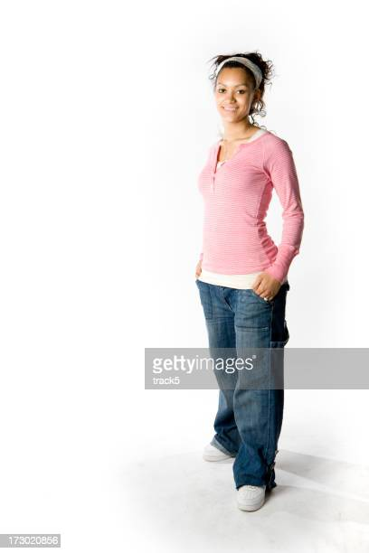 Full-length portrait of a casually dressed friendly teenage mixed-race girl