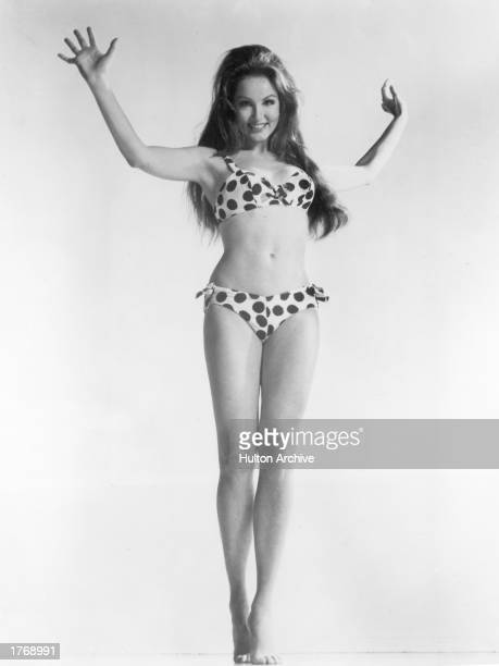 Fulllength portrait of American actor Julie Newmar wearing a polka dotted bikini 1960s