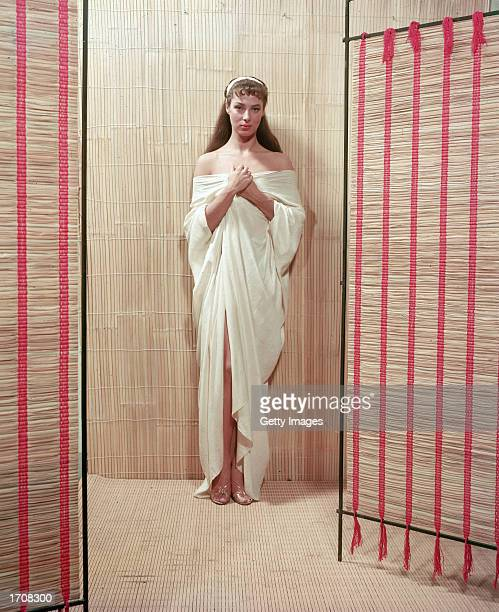 Fulllength portrait of American film actor and theater producer Rita Gam clothed in classical drapery 1950s