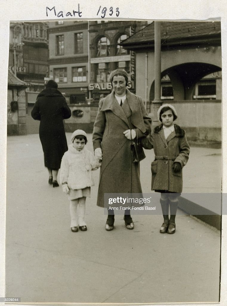 Full-length portrait of Edith Frank with her daughters, Anne (left) and Margot (right) in downtown Frankfurt am Main, Germany. Taken from <a gi-track='captionPersonalityLinkClicked' href=/galleries/search?phrase=Anne+Frank&family=editorial&specificpeople=173492 ng-click='$event.stopPropagation()'>Anne Frank</a>'s photo album.