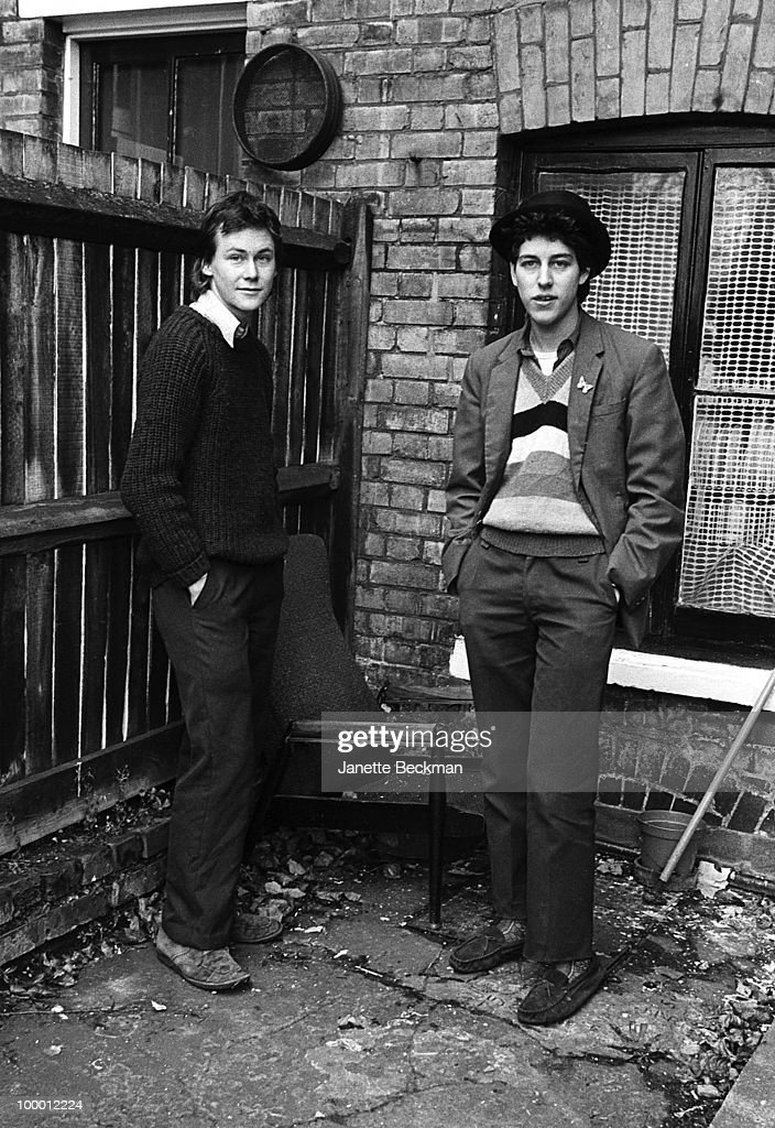 Full-length portrait of non-musicians Bendle Calder and Nag Vladermersky, professionally known as Bendle and Nag, who performed in the experimental punk band The Door and The Window, among numerous others, London, 1980.