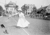 Fulllength portrait of tennis player Violet Summerhays delivering backhand stroke during a match at a tennis club in Chicago 1903 From the Chicago...