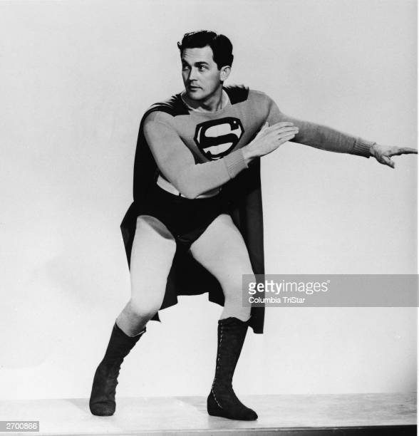 Fulllength promotional portrait of American actor Kirk Alyn posing in costume as 'Superman' from the film serial 1948