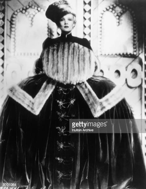 Fulllength promotional portrait of Germanborn actor Marlene Dietrich in costume as Russian empress Catherine II for director Josef von Sternberg's...