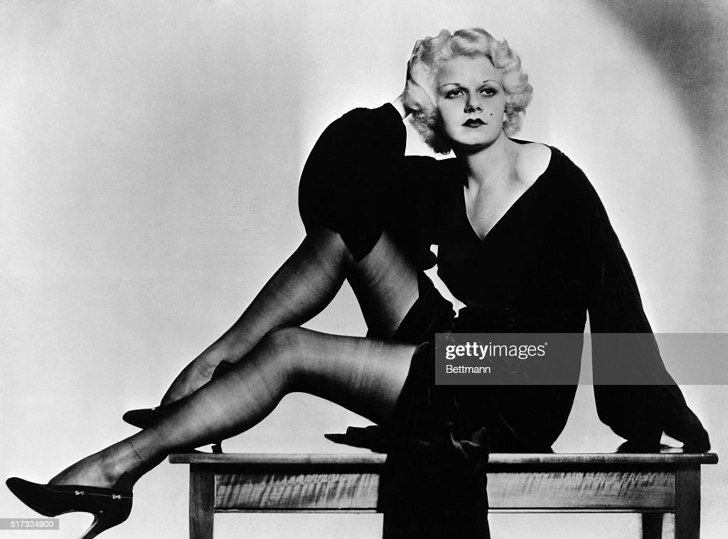 Full-length seated portrait of <a gi-track='captionPersonalityLinkClicked' href=/galleries/search?phrase=Jean+Harlow&family=editorial&specificpeople=70012 ng-click='$event.stopPropagation()'>Jean Harlow</a>, siren of the 1930's. Undated photograph.