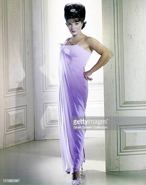 Fulllength shot of Connie Francis US singer wearing a long lilac dress with her hair in a beehive hairstyle circa 1965