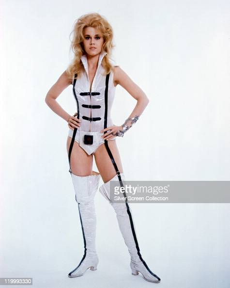 Fulllength shot of Jane Fonda US actress in costume in a studio portrait against white background issued as publicity for the film 'Barbarella' 1968...