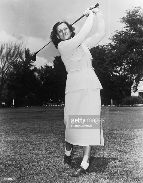 Fulllength view of American golfer Mildred 'Babe' Didrikson Zaharias swinging a golf club over her shoulder on a golf course She was a founding...