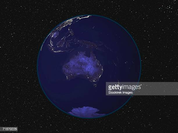 'Fully dark image of Earth at night centered on Australia and Oceania, showing city lights.'