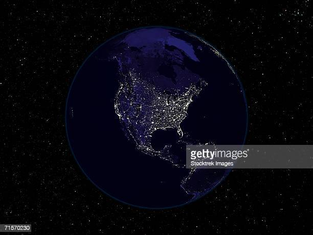 Fully dark image of Earth at night centered on North America showing city lights.