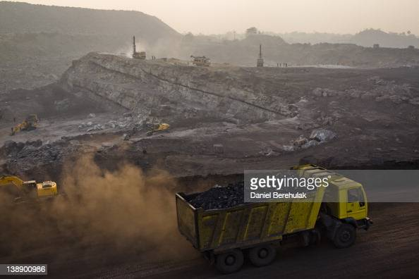 A fully laden truck carrying coal drives out of an opencast coal mine as excavation work continues in the village of Jina Gora on February 09 2012...