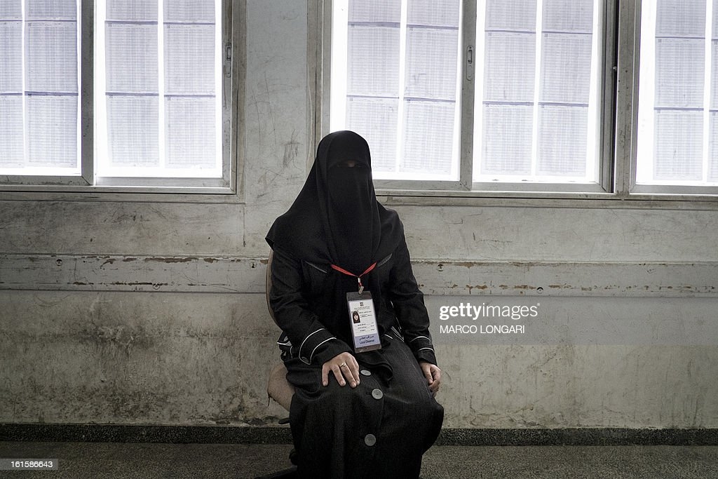 A fully-veiled electoral commission official sits in a registration office in Gaza City on February 12, 2013. Palestinian electoral officials began the long-overdue process of updating voter rolls in the West Bank and Gaza in a vital step towards eventual elections. AFP PHOTO/MARCO LONGARI