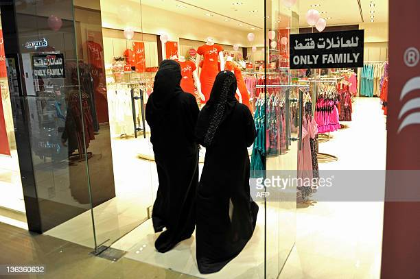 Fullyveiled Saudi women enter a lingerie shop for women and families only in the Saudi Red Sea port of Jeddah on January 2 2012 From this week only...