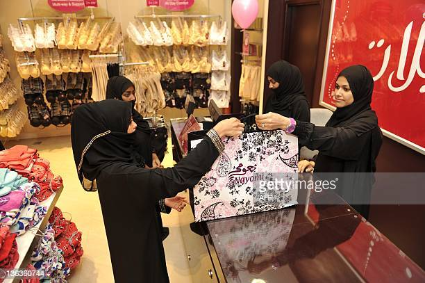Fullyveiled Saudi women shop at a lingerie store in the Saudi Red Sea port of Jeddah on January 2 2012 From this week only female staff will be able...