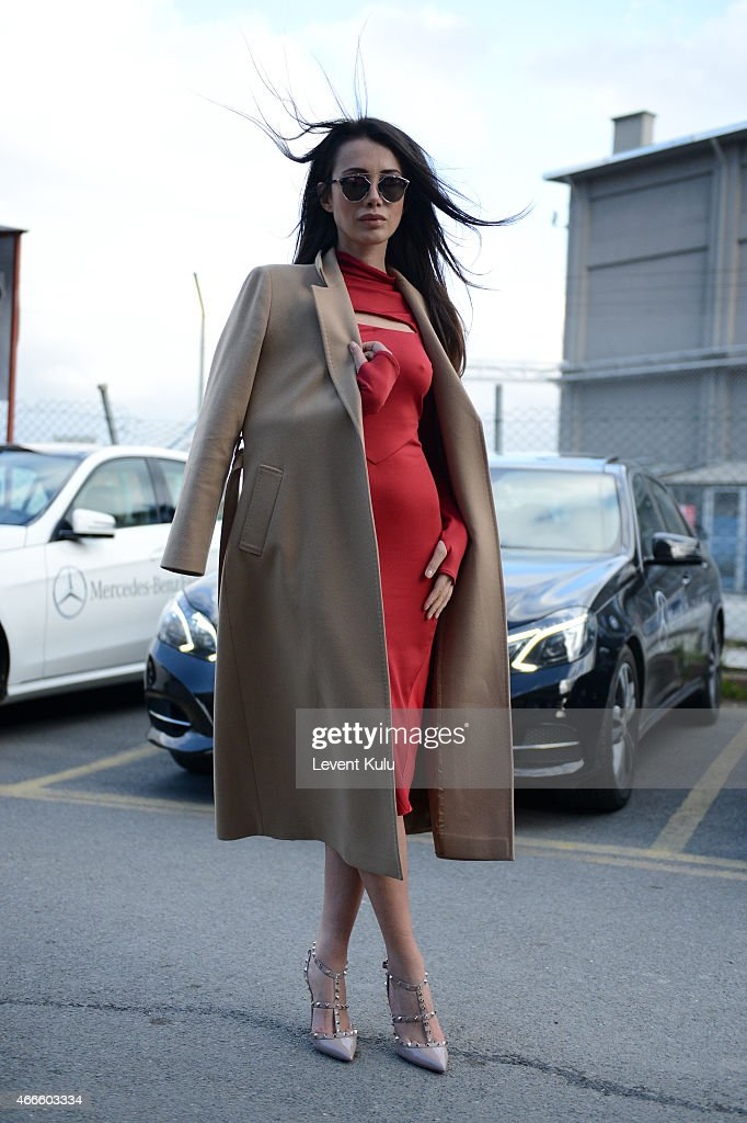 Fulya Sezen poses wearing dress by Ju Istanbul shoes by Valentino and sunglasses by Christian Dior during Mercedes Benz Fashion Week Istanbul FW15 on...