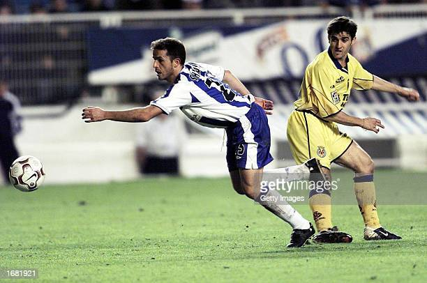 Fumero Sandro of Malaga and Victor of Villarreal in action during the Primera Liga match between Malaga and Villarreal played at La Rosaleda Stadium...