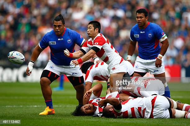 Fumiaki Tanaka of Japan passes during the 2015 Rugby World Cup Pool B match between Samoa and Japan at Stadium mk on October 3 2015 in Milton Keynes...
