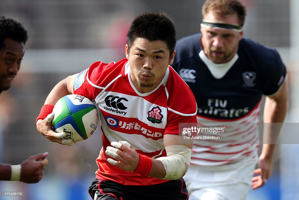 <a gi-track='captionPersonalityLinkClicked' href=/galleries/search?phrase=Fumiaki+Tanaka&family=editorial&specificpeople=5409297 ng-click='$event.stopPropagation()'>Fumiaki Tanaka</a> of Japan runs with the ball during the Pacific Nations Cup match between Japan and USA at Prince Chichibu Stadium on June 23, 2013 in Tokyo, Japan.