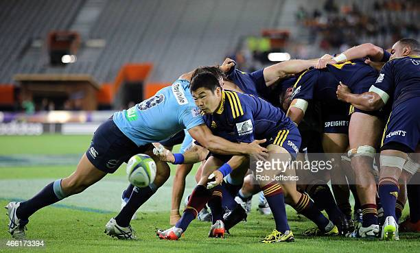Fumiaki Tanaka of the Highlanders passes the ball during the round five Super Rugby match between the Highlanders and the Waratahs at Forsyth Barr...