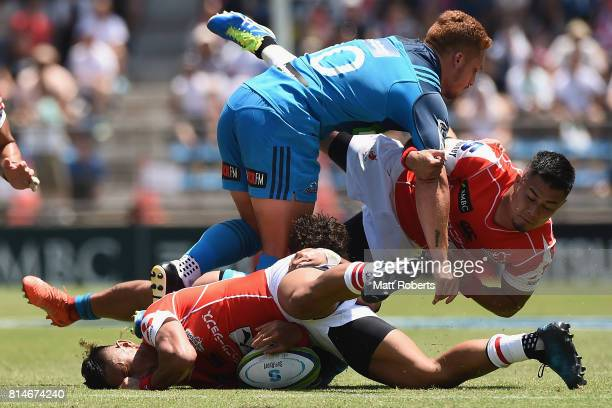 Fumiaki Tanaka of the Sunwolves is tackled during the Super Rugby match between the Sunwolves and the Blues at Prince Chichibu Stadium on July 15...