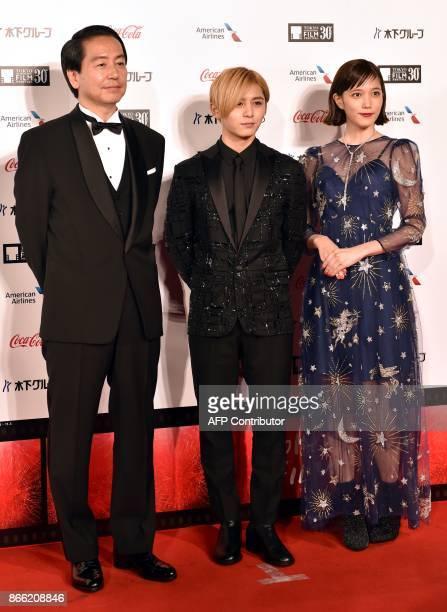 Fumihiko Sori Japanese director of 'FULLMETAL ALCHEMIST' poses with actor Ryosuke Yamada and actress Tsubasa Honda in a photo session prior to the...