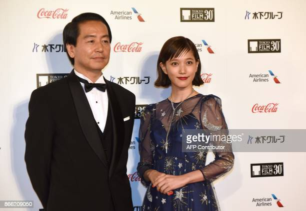 Fumihiko Sori Japanese director of 'FULLMETAL ALCHEMIST' poses with actress Tsubasa Honda in a photo session prior to the opening ceremony of the...