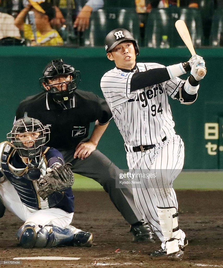 Fumihito Haraguchi hits a tworun home run in the eighth inning of the Hanshin Tigers' 20 win over the Orix Buffaloes in interleague play at Koshien...