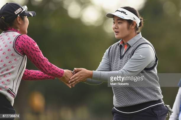 Fumika Kawagishi of Japan and Saiki Fujita of Japan shake hands during the second round of the Itoen Ladies Golf Tournament 2017 at the Great Island...