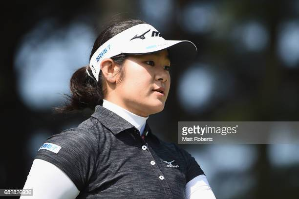 Fumika Kawagishi of Japan looks on after her tee shot on the 3rd hole during the final round of the HokennoMadoguchi Ladies at the Fukuoka Country...